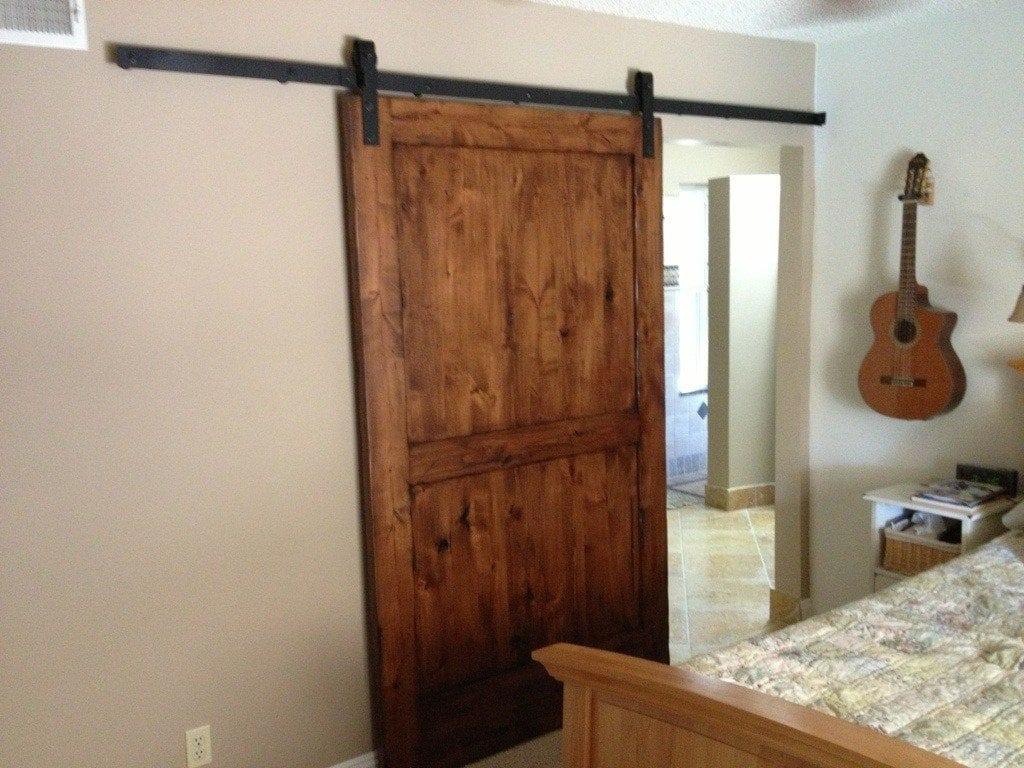 Knotty alder distressed sliding door porter barn wood for Distressed wood interior doors
