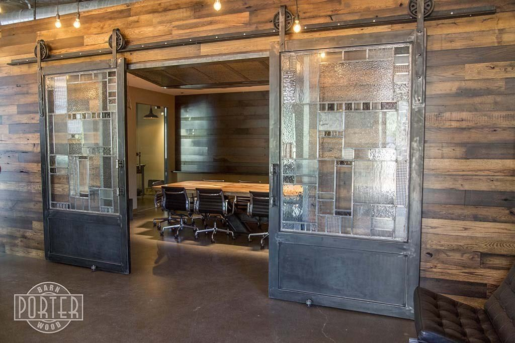 Conference room wood wall covering sliding steel doors porter barn wood