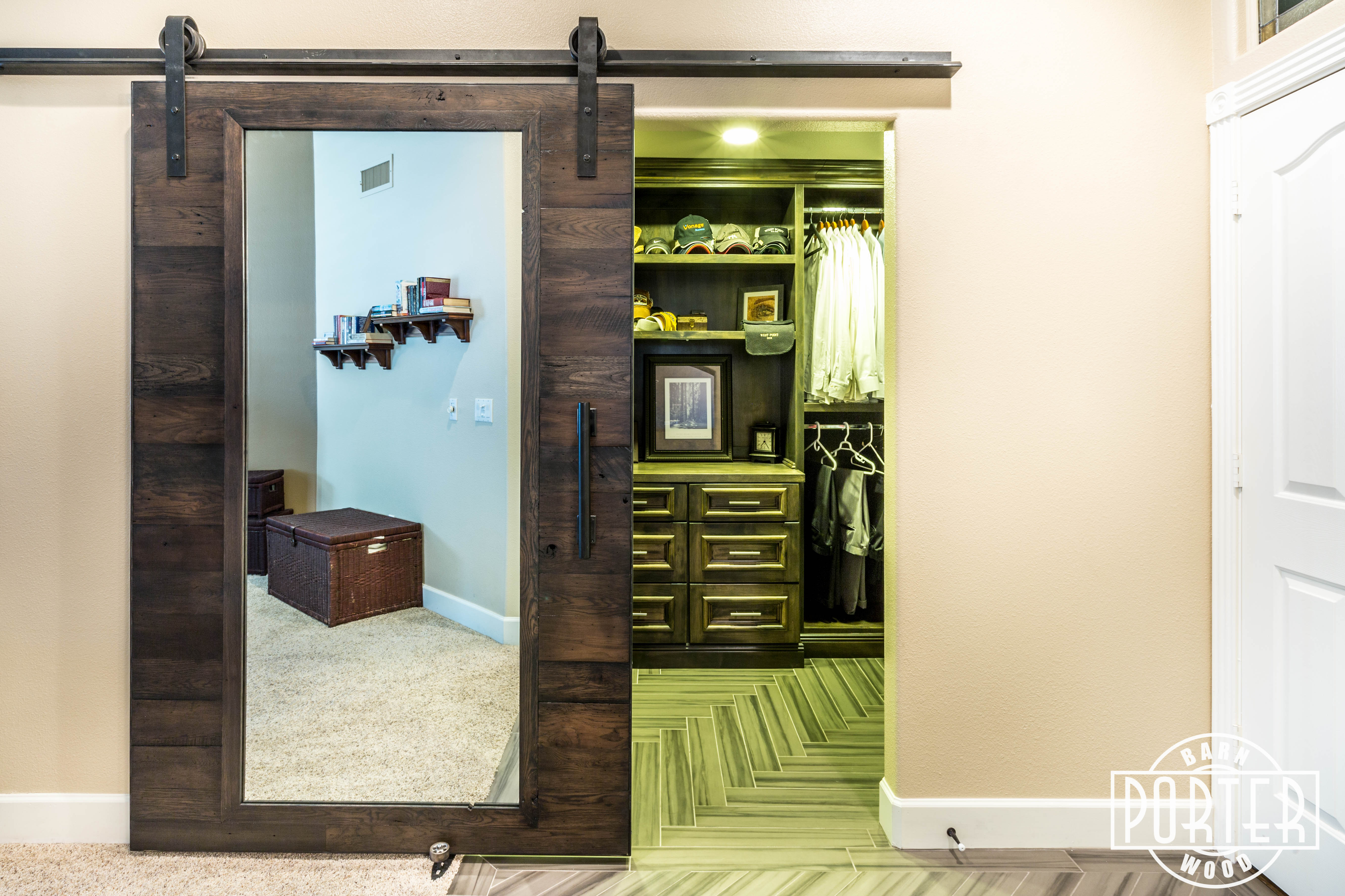 here is a reclaimed oak sliding barn door with mirror we built and installed for a customer this door is made from our blacku201d materials that have