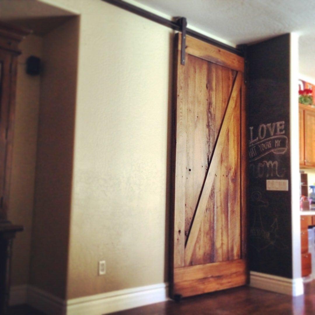 Reclaimed mixed hardwood sliding barn door z pattern low for Wooden sliding doors