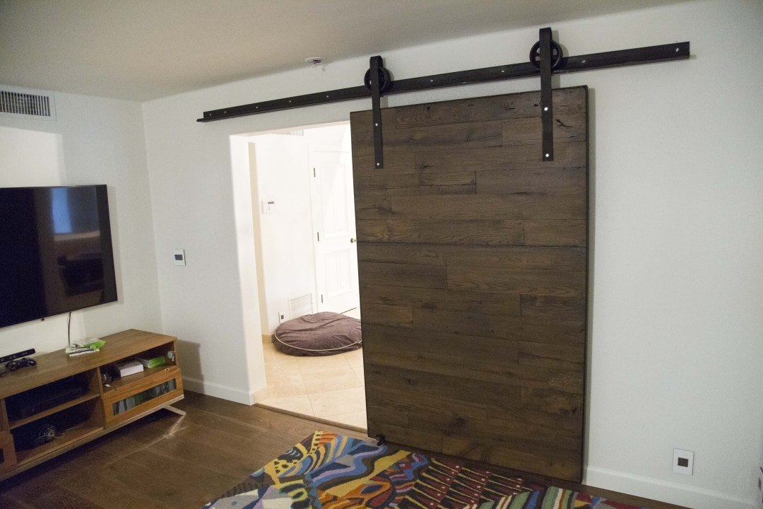 Two Reclaimed Speckled Black Sliding Barn Doors
