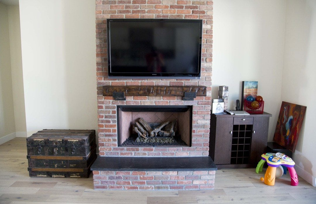 Hand Hewn Pine Mantel with Custom Steel Brackets