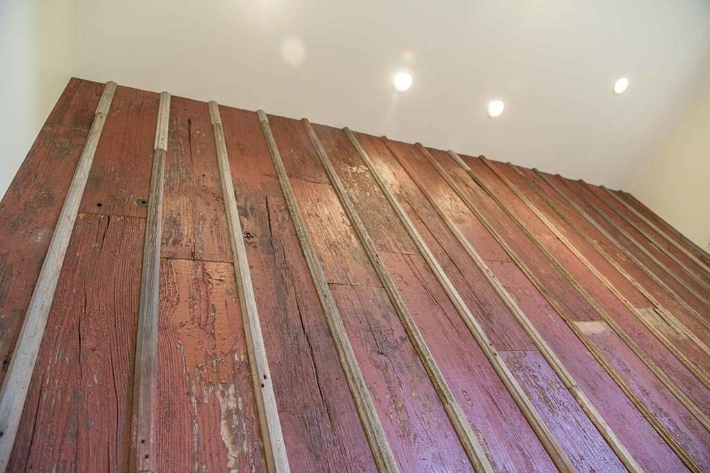 Distressed Red Reclaimed Board And Batten Wood Wall