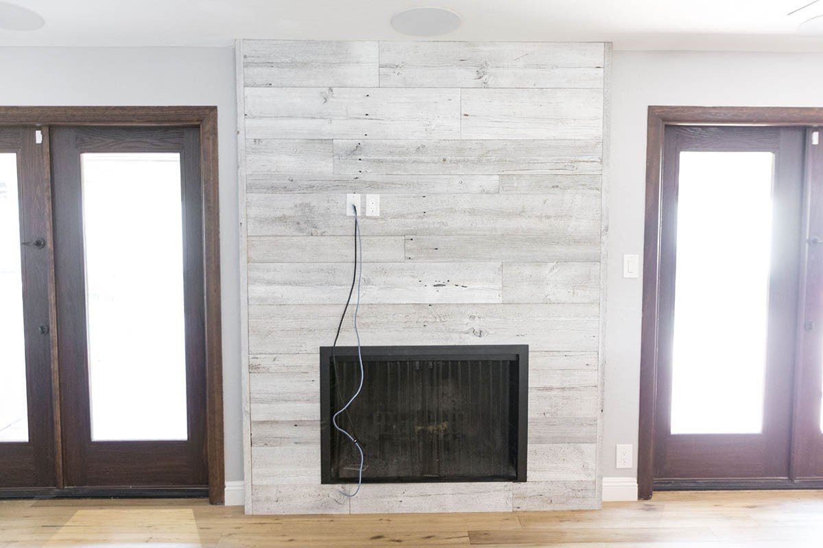 distressed white iowa pine wood wall w steel fireplace frame