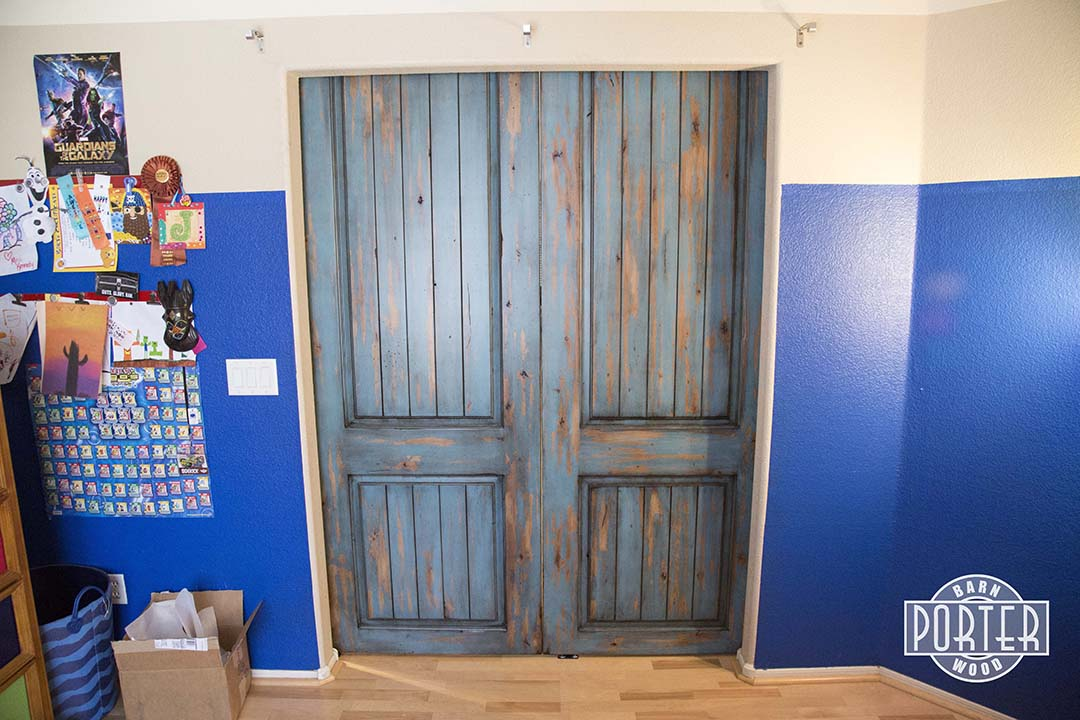 Distressed Paneled Sliding Doors with Ignite Finish