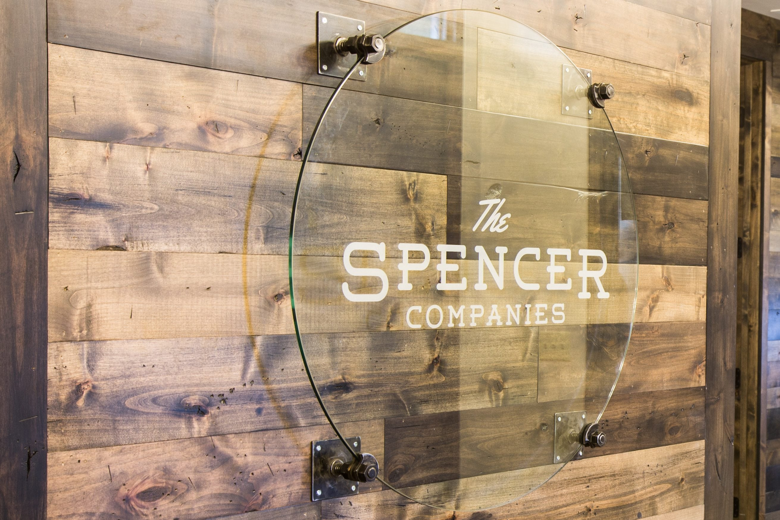 The Spencer Companies Glass Logo