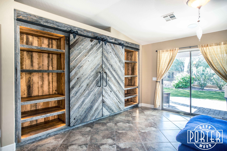 Akers built in entertainment center porter barn wood for Built in sliding doors